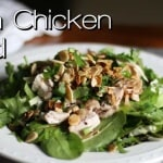 Bruce Bradley's Asian Chicken Salad is a delicious blend of salad greens, cilantro, green onions, chicken, and almonds—all with a dressing that really makes this salad pop!