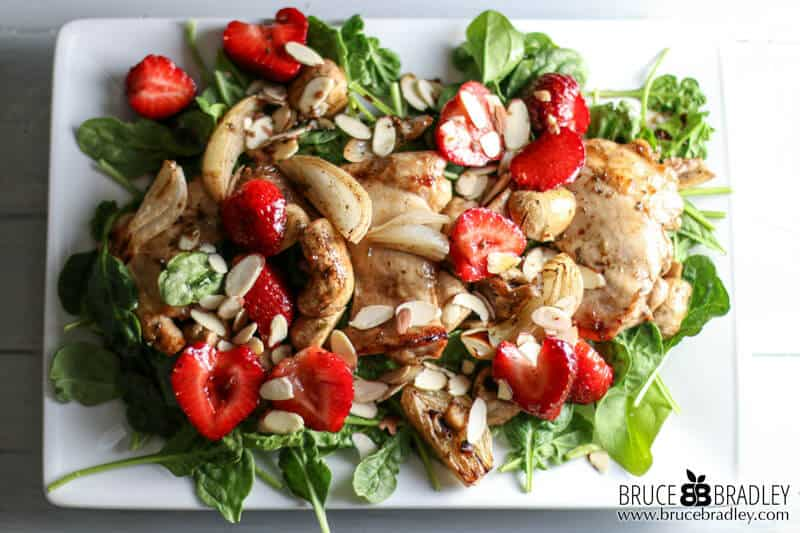This clean eating recipe for Strawberry Spinach Salad looks and tastes amazing and is made with Roasted Chicken or tofu plus marinated mushrooms & strawberries!